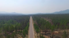 Aerial View Road In The Coniferous Forest On Lake Stock Footage