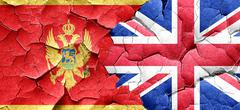 Montenegro flag with Great Britain flag on a grunge cracked wall Stock Illustration