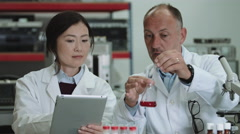 Scientist team working in laboratory Stock Footage