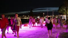 People walking in a summer night along the Croisette in Cannes Stock Footage