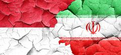 Monaco flag with Iran flag on a grunge cracked wall Stock Illustration