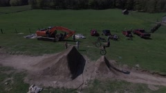 4k aerial mtb dirt jump line Stock Footage
