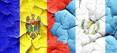 Moldova flag with Guatemala flag on a grunge cracked wall - stock illustration