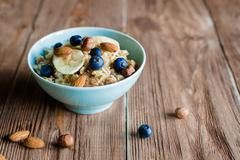 Oat porridge breakfast with nuts and berries Stock Photos