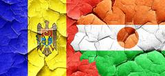Moldova flag with Niger flag on a grunge cracked wall Stock Illustration