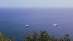 Mediterranean blue, calm sea with boats and horizon in the morning Stock Footage