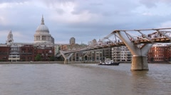 St Paul's cathedral and Millennium bridge in London in the afternoon Stock Footage