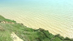View from precipice on muddy sea Stock Footage