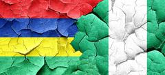 Mauritius flag with Nigeria flag on a grunge cracked wall Piirros
