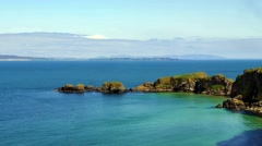 View along the coast to rope bridge Carrick-a-Rede, Ballintoy, Northern Ireland Stock Footage