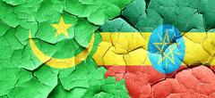 Mauritania flag with Ethiopia flag on a grunge cracked wall Stock Illustration