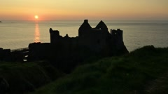 Dunluce Castle during sunset, Northern Ireland Stock Footage