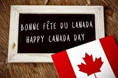 text Happy Canada Day in French and English - stock photo
