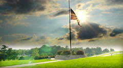 HDR of large flag beilg flown at Half Staff - stock footage