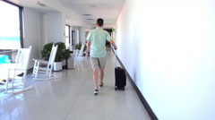 Airline Passenger Walking Down Airport Hallway Stock Footage