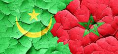 Mauritania flag with Morocco flag on a grunge cracked wall Stock Illustration