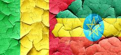 Mali flag with Ethiopia flag on a grunge cracked wall Stock Illustration