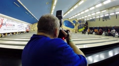 Man with camera during bloggers meeting in Asteroid bowling club Stock Footage