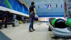 Girl throws ball during bloggers meeting in Asteroid bowling club Stock Footage