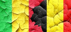 Mali flag with Belgium flag on a grunge cracked wall Stock Illustration