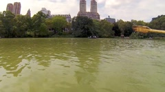 Paddle of boat floating on pond in Central Park in New York Stock Footage