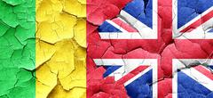 Mali flag with Great Britain flag on a grunge cracked wall - stock illustration