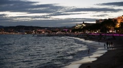 Cannes illuminated coast and Croisette view in the evening Stock Footage