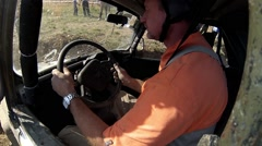 Driver in car during off-road competition RainForest Challenge Russia Stock Footage