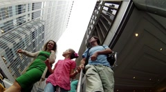 Man, woman and girl (with model releases) near Hilton main office Stock Footage