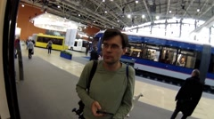 Man (with model release) inside bus at exhibition ExpoCityTrans Stock Footage