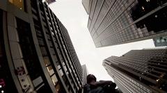 Man goes with selfie stick down street in Manhattan borough Stock Footage