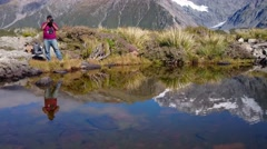 Photographer Beside Tarn At Hooker Track, Mount Cook Stock Footage