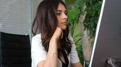 Bored businesswoman working on laptop in office Stock Footage