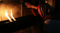 A woman praying in the Church of the Holy Sepulchre in Jerusalem Stock Footage