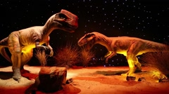 Two dinosaurs at Show of dinosaurs in pavillion of VDNKH Stock Footage