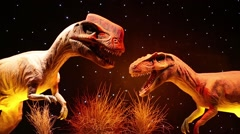 Heads of two dinosaurs at Show of dinosaurs in pavillion of VDNKH Stock Footage