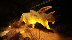 Robotic triceratops at Show of dinosaurs in pavillion of VDNKH Stock Footage