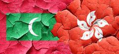 Maldives flag with Hong Kong flag on a grunge cracked wall Piirros