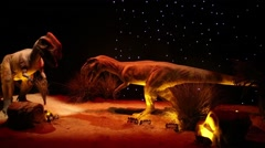 Two robotic dinosaurs at Show of dinosaurs in pavillion of VDNKH Stock Footage