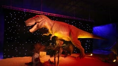 Tyrannosaurus Rex and child shoots it at Show of dinosaurs Stock Footage