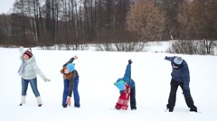 Happy family of four do exercises outdoor at winter day Stock Footage