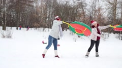 Two women play with snow tubes outdoor at winter day Stock Footage