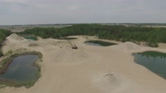 4k aerial over sand pit and heavy machinery Stock Footage