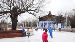 Happy people skate on ice rink in VDNKh park in Moscow Stock Footage