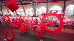 Large red bikes in exhibition Mechanics of Marvel in pavillion of VDNH Stock Footage