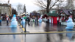 People walk in VDNH park with christmas decorations and kiosks Stock Footage