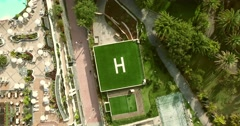 AERIAL: rotation shot of a square helicopter parking spot. - stock footage