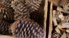 Close up view of cones in wicker baskets and beautiful gingerbread house Stock Footage