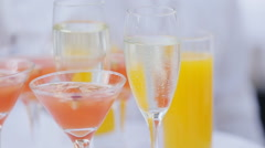 A waiter with a tray of glasses of champagne, delicious apple punch - stock footage