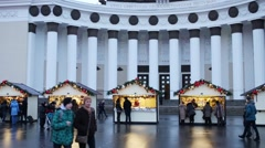 People walk near main pavillion with christmas decorations Stock Footage